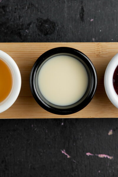 pancake sauces honey condensed milk berry jam top view